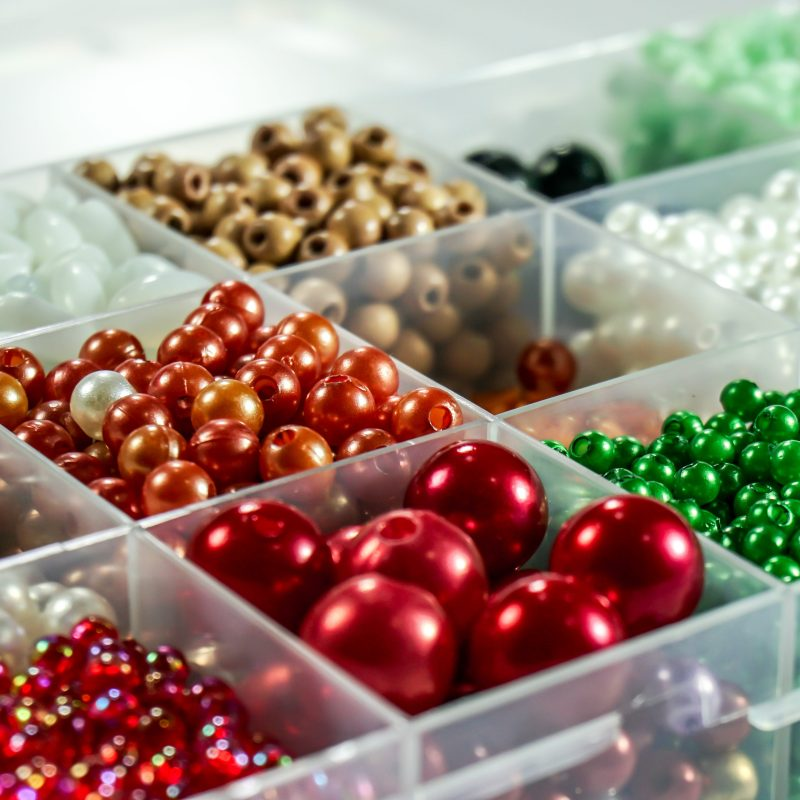well organized green white and red beads in a storage box container for christmas in Asheville